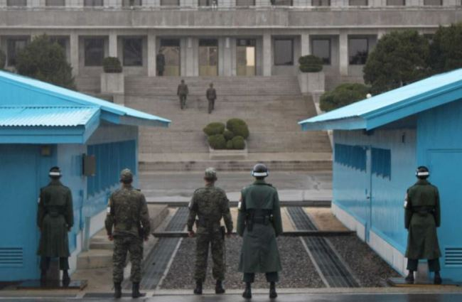 South Korean soldiers stand on guard as they face the North Korea side at the border village of Panmunjeom in the demilitarized zone, South Korea. (AP)