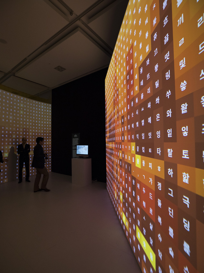 """Visitors view """"SoundXHangeul: Variation Of The Korean Alphabet"""" at the Special Exhibition Hall at the National Hangeul Museum in Seoul on Monday. (Yonhap)"""