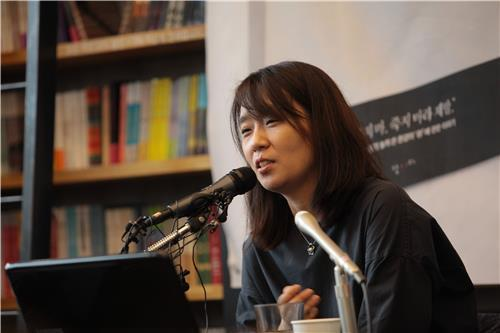 In this photo provided by her publisher Nanda, South Korean author Han Kang speaks during a press briefing about her new book,
