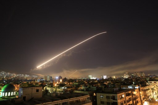 The Damascus sky lights up missile fire as the U.S. launches an attack on Syria targeting different parts of the capital early Saturday, April 14, 2018. Syria`s capital has been rocked by loud explosions that lit up the sky with heavy smoke as U.S. President Donald Trump announced airstrikes in retaliation for the country`s alleged use of chemical weapons. (AP)