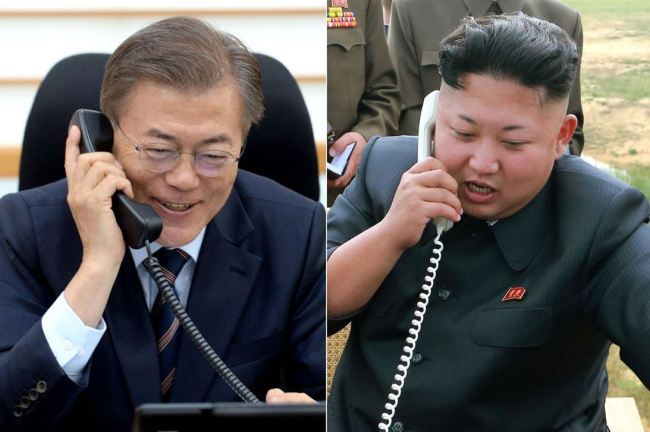 File photo of leaders of South and North Korea respectively on phone (Yonhap)