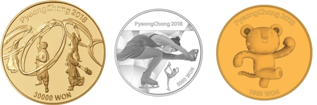 From left: A 30,000 won Olympic commemorative gold coin depicts a Korean folk game
