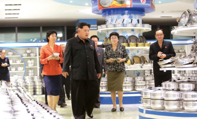 North Korean leader Kim Jong-un visits a store selling dinnerware in Pyongyang. (Yonhap)