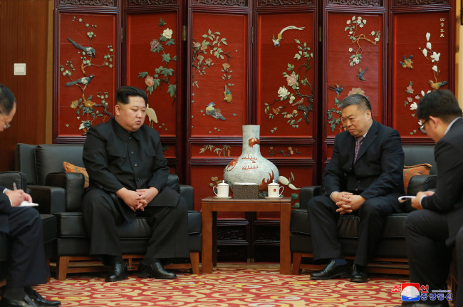 This photo, carried by North Korea's state-run news agency on April 24, 2018, shows North Korean leader Kim Jong-un (left) visiting China's Embassy in Pyongyang to mourn Chinese tourists killed in bus accident that occurred in the North days earlier. (For Use Only in the Republic of Korea. No Redistribution) (Yonhap)