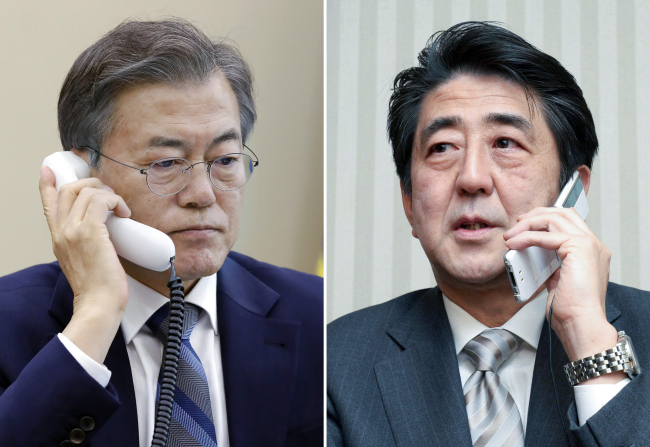 President Moon Jae-in (left) and Japanese Prime Minister Shinzo Abe. Yonhap