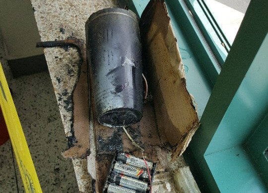 Pictured is an explosive made from a coffee tumbler, gunpowder and four AA batteries that was found inside a professor's office at Yonsei University in western Seoul on June 13, 2017. (Yonhap)