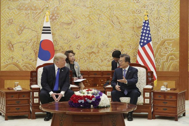 President Moon Jae-in and US President Donald Trump during their third summit meeting in Seoul on Nov. 7. Cheong Wa Dae