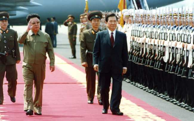 North Korea`s late leader Kim Jong-un and former South Korean President Kim Dae-jung were greeted by the North Korean military guards during their meeting in 2000. Yonhap