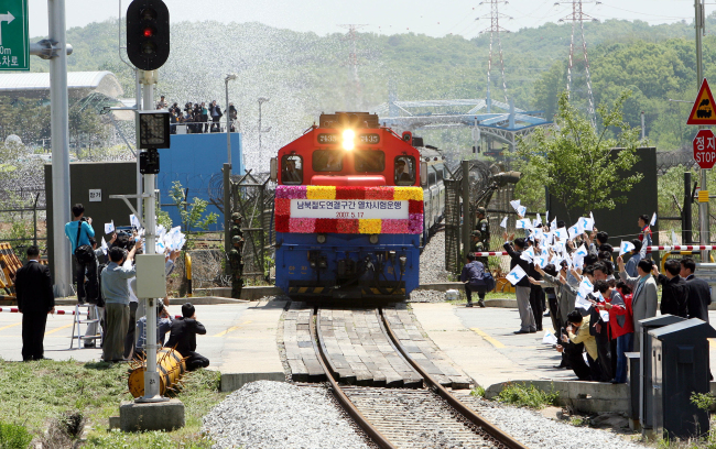 Following the decision to restore Gyeongui Line in 2007, a train crosses the border and heads toward the North Korean territory. Yonhap