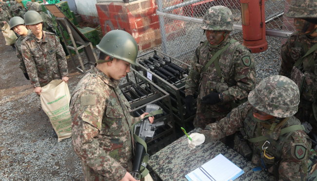 South Korean soldiers received firearms for logistics training at the Army's 31 Infantry division on Thursday. Yonhap