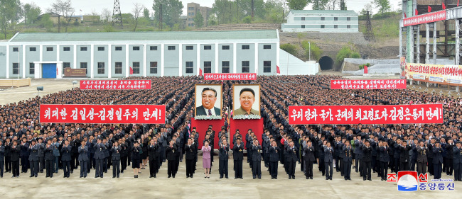 North Koreans celebrates the annual labor day at a steel making plant site in Hwanghae Province on May 1. (Yonhap)