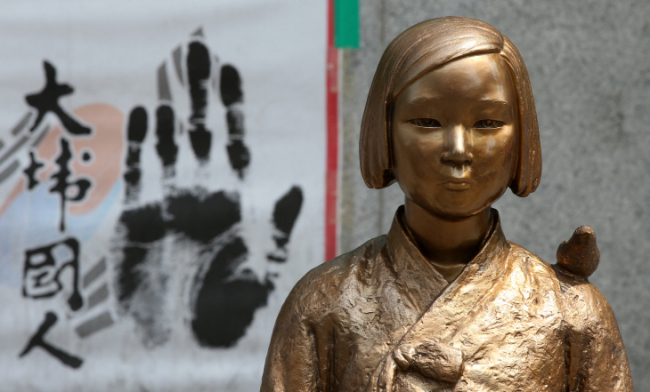 "A ""comfort woman"" statue outside the Japanese Embassy in Jongno, central Seoul. (Yonhap)"