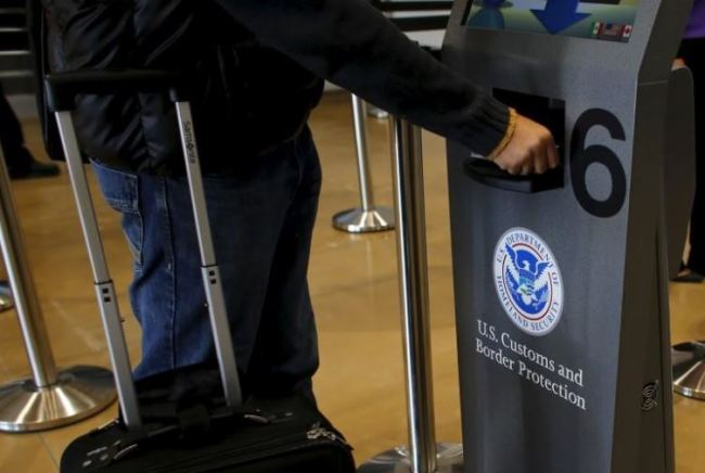 A traveler has his passport scanned as he passes through U.S. Customs and Immigration. (Reuters)