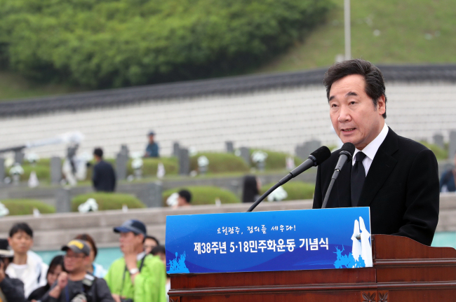 Prime Minister Lee Nak-yon speaks at the 38th commemoration of the May 18 Democratization Movement at May 18 National Cemetery in the southwestern city of Gwangju on Friday. (Yonhap)