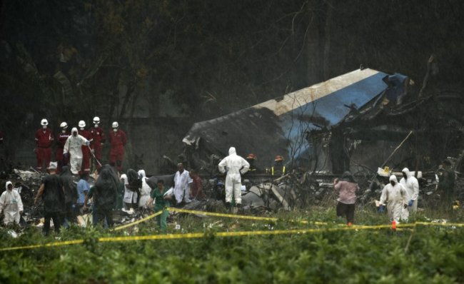 Rescue teams search through the wreckage site of a Boeing 737 that plummeted into a cassava field with more than 100 passengers on board, in Havana, Cuba, Friday, May 18. (AP)