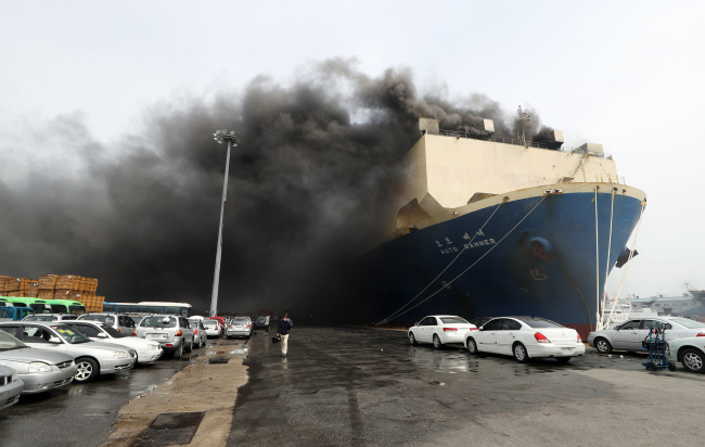 A big fire takes place on a Panama-registered car carrier at the port of Incheon on May 21, 2018. (Yonhap)
