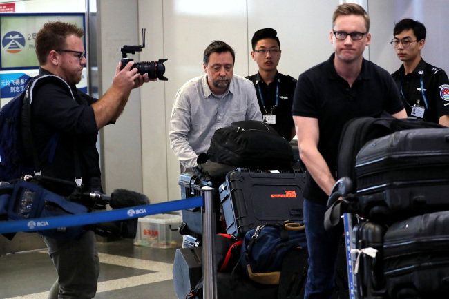 Will Ripley (front, right) from CNN and other foreign journalists head to catch a flight to Wonsan, North Korea, at Beijing Capital Airport on Tuesday. (Pool-Yonhap)