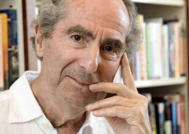 In this Sept. 8, 2008, file photo, author Philip Roth poses for a photo in the offices of his publisher, Houghton Mifflin, in New York. (AP)