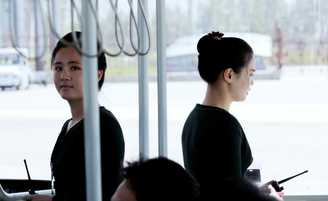 North Korean guides on a bus carrying South Korean reporters at the Kalma Airport, Wonsan, Wednesday. (Joint Press Corps)