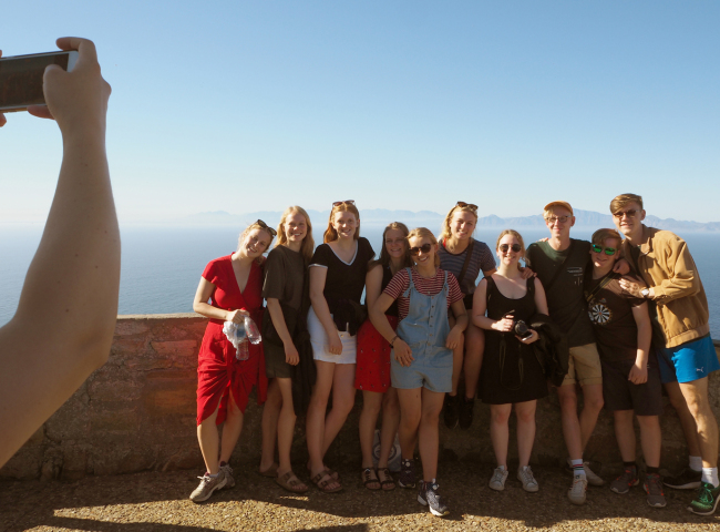 A group of students from Denmark pose for a photo at the Cape of Good Hope's Old Lighthouse (Joel Lee/The Korea Herald)