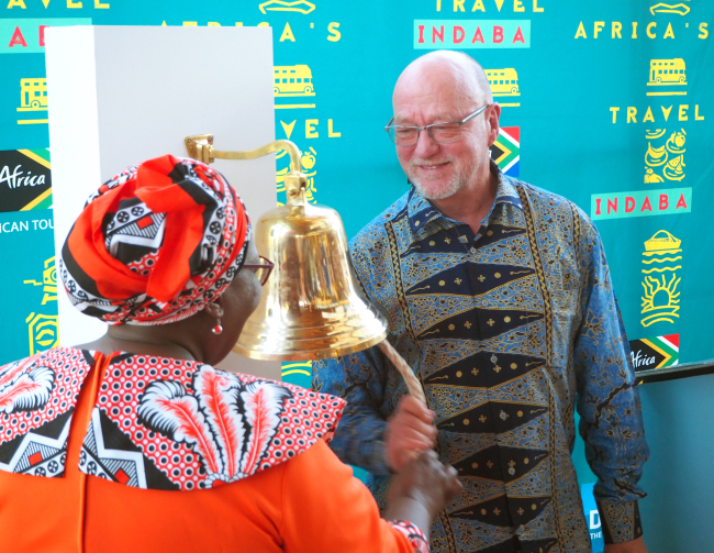 South African Tourism Minister Derek Hanekom (right) and Deputy Minister Elizabeth Thabethe ring the bell signaling the start of the 2018 African Travel Indaba on May 8 at the Durban International Convention Center. (Joel Lee/The Korea Herald)