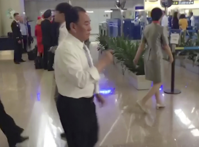 In this image made from video, Kim Yong-chol (in white), a former military intelligence chief who is now Kim Jong-un's top official on inter-Korean relations, walks upon arrival at Beijing airport in Beijing Tuesday. (AP-Yonhap)