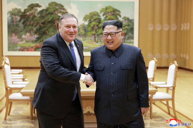 North Korean leader Kim Jong-un met with US Secretary of State Mike Pompeo, who conveyed Trump's oral message concerning the North Korea-US summit, on May 10. (AP-Yonhap)