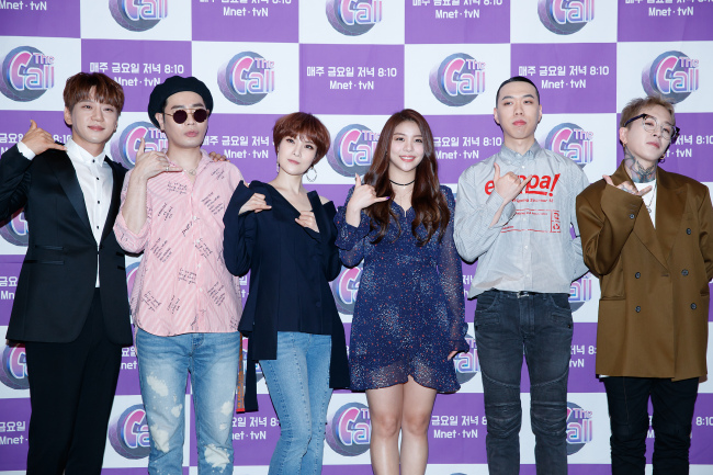 """Casts of Mnet's music program """"The Call"""" pose during a press conference in Seoul on Wednesday. (CJ E&M)"""