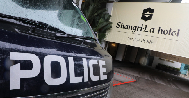 A police car is parked in front of the Shangri-La Hotel on Thursday. (Yonhap)