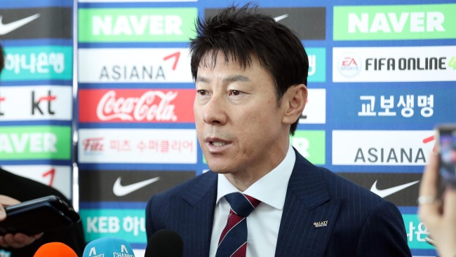 South Korea men`s national football team head coach Shin Tae-yong speaks to reporters at Incheon International Airport in Incheon before departing for their pre-World Cup training camp in Austria on June 3, 2018. (Yonhap)