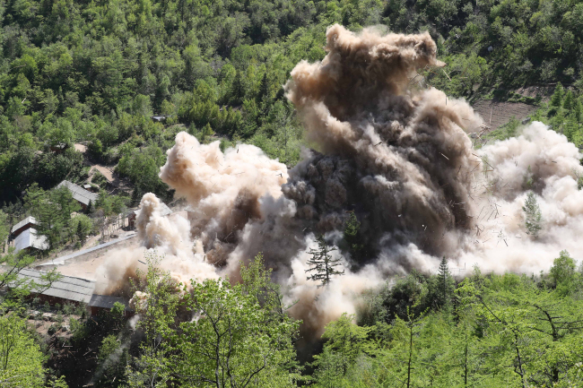 This pool photo shows the demolition of North Korea`s Punggye-ri nuclear test site on May 24, 2018. (Yonhap)