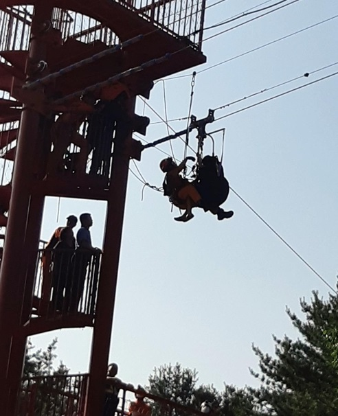 Emergency services respond to a 9-year-old stuck on a zip line. (Yonhap)