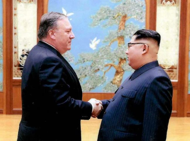In this image released by the White House, Mike Pompeo shakes hands with North Korean leader Kim Jong Un in Pyongyang, North Korea, during a 2018 trip. (AP)
