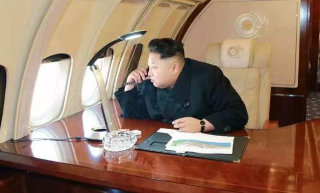 Kim photographed on his remodeled II-62 while flying over Pyongyang to survey a large construction project. (KCNA)