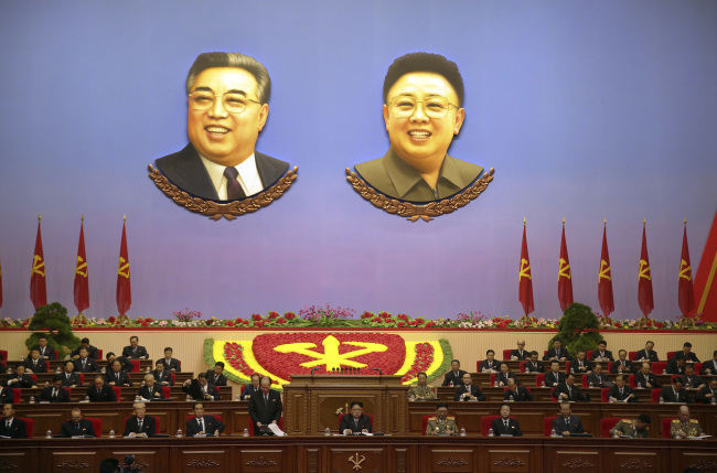 Portraits of late North Korean leaders Kim Il Sung, left, and his son, Kim Jong Il, hang inside the convention hall of the April 25 House of Culture, where the party congress is held in Pyongyang, North Korea. (AP)