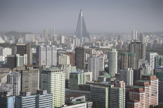 The 105-story pyramid-shaped Ryugyong Hotel towers over residential apartments, forming the skyline of Pyongyang, North Korea. (AP)