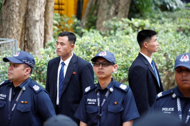 North Korean security personnel are stationed at the St Regis hotel, where North Korean leader Kim Jong-un will stay. (AP-Yonhap)