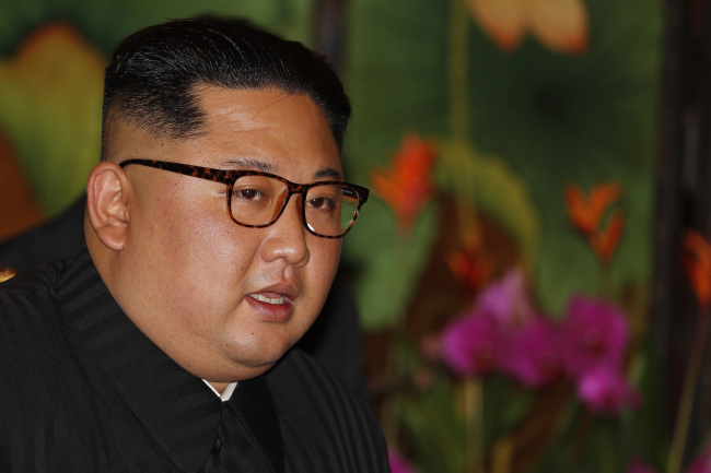 A close-up of Kim Jong-un as he speaks to Singapore's Prime Minister Lee Hsien Loong (AP-Yonhap)