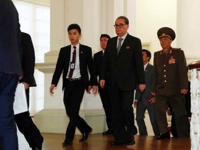 Ri Su-yong, a member of the North Korean delegation, walks in the Istana. (Reuters-Yonhap)