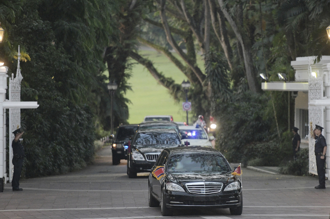 Kim Jong-un leaves the Istana, or Presidential Palace, in Singapore. (AP-Yonhap)