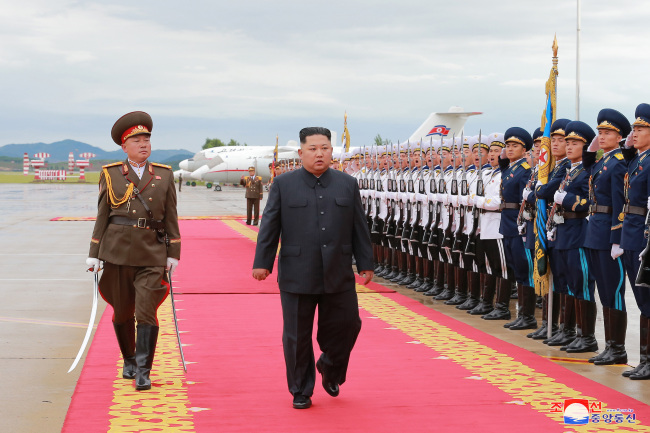 This photo, taken from the Korean Central News Agency on June 11, 2018, shows North Korean leader Kim Jong-un inspecting an honor guard in Pyongyang before leaving for Singapore the previous day. Kim will hold a historic summit with US President Donald Trump in the city-state on June 12. (For Use Only in the Republic of Korea. No Redistribution) (Yonhap)
