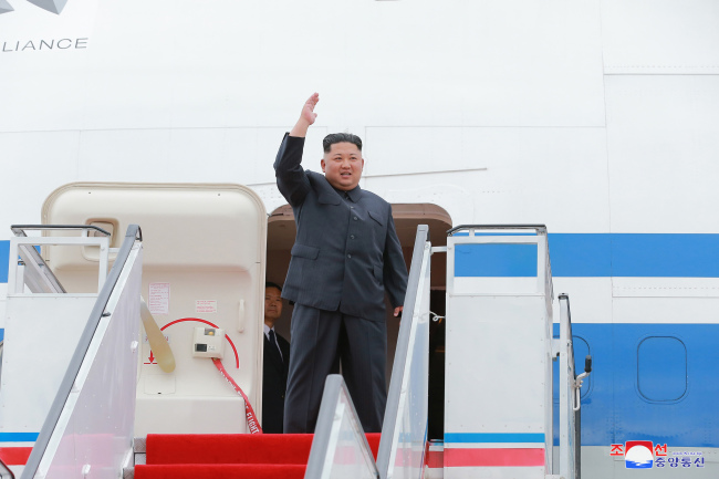 This photo, taken from the Korean Central News Agency on June 11, 2018, shows North Korean leader Kim Jong-un before leaving for Singapore the previous day. (Yonhap)