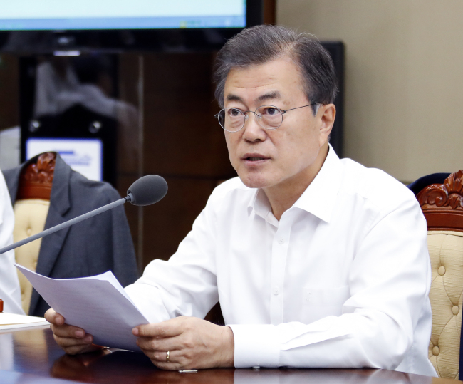 South Korean President Moon Jae-in presides over a meeting on Monday with his senior secretaries at the Presidential Blue House in Seoul, a day before the Kim-Trump summit in Singapore. Yonhap