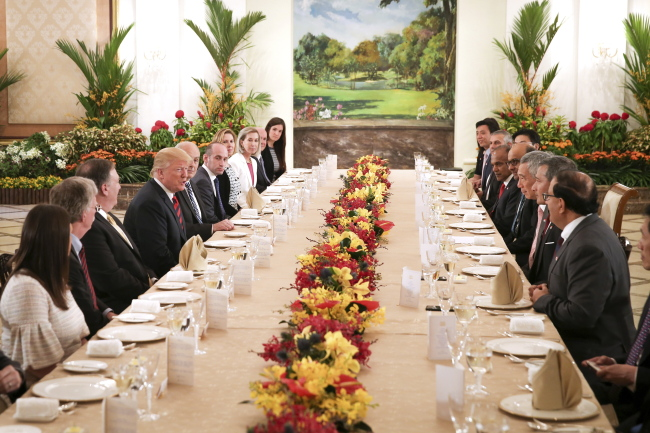 US President Donald J. Trump (4-L) and Singapore Prime Minister Lee Hsien Loong (4-R) meet for a working lunch at The Istana (presidential residence) in Singapore on Monday. (EPA-Yonhap)