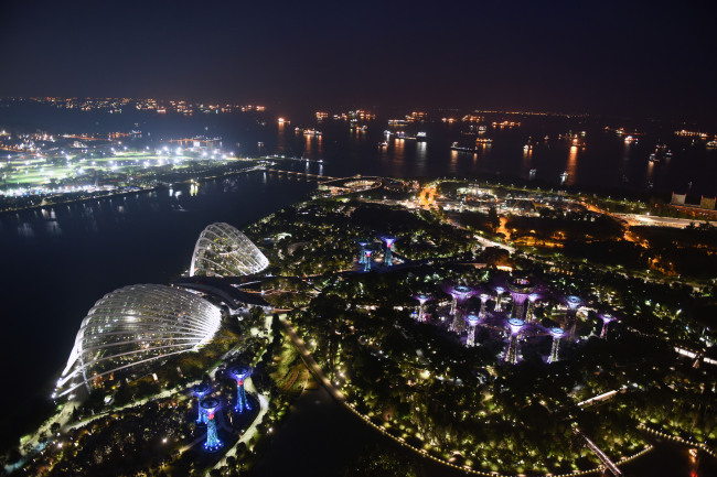Photo taken on Monday shows a night view of Singapore. The much-anticipated meeting between U.S. President Donald Trump and Kim Jong Un, top leader of the Democratic People's Republic of Korea (DPRK) is to start here on Tuesday. (Xinhua-Yonhap)