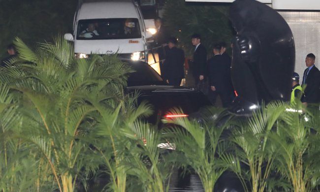Kim Jong-un's vehicle is seen leaving the St. Regis Singapore on Monday night. (Yonhap)