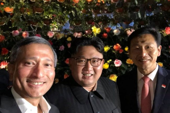 Singapore's Foreign Minister Vivian Balakrishnan (left) posted a picture taken with North Korean leader Kim Jong Un (center) and Education Minister Ong Ye Kung on his Facebook account Monday (Vivian Balakrishnan's Facebook)