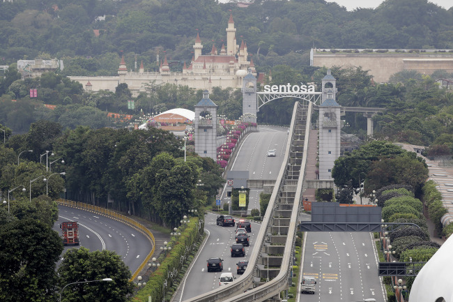 A car carrying United States President Donald Trump enters Sentosa island where the summit between him and North Korean leader Kim Jong Un will take place at the Capella Hotel on Tuesday. (Reuters)