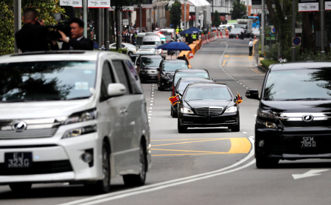 The motorcade of North Korean leader Kim Jong Un travels towards Sentosa for his meeting with US President Donald Trump, in Singapore on Tuesday. (Reuters)