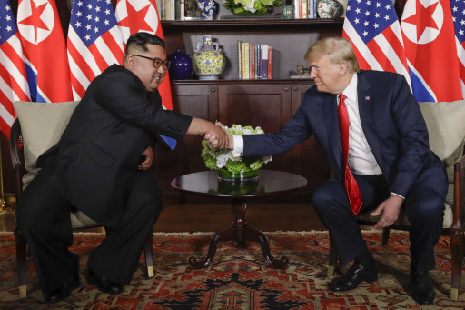 US President Donald Trump shakes hands with North Korea leader Kim Jong-un during their first meetings at the Capella resort on Sentosa Island Tuesday, June 12, 2018 in Singapore. (AP)